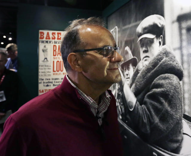 Former New York Yankees manager Joe Torre tours a Babe Ruth exhibit during his orientation visit at the Baseball Hall of Fame on Tuesday, March 25, 2014, in Cooperstown, N.Y. Torre will be inducted to the hall in July. (AP Photo/Mike Groll)