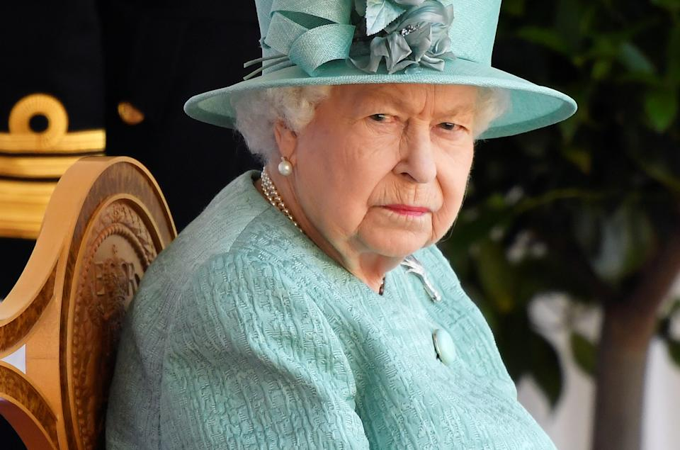 Britain's Queen Elizabeth II attends a ceremony to mark her official birthday at Windsor Castle in Windsor, southeast England on June 13, 2020, as Britain's Queen Elizabeth II celebrates her 94th birthday this year. (Photo by TOBY MELVILLE / POOL / AFP) (Photo by TOBY MELVILLE/POOL/AFP via Getty Images)