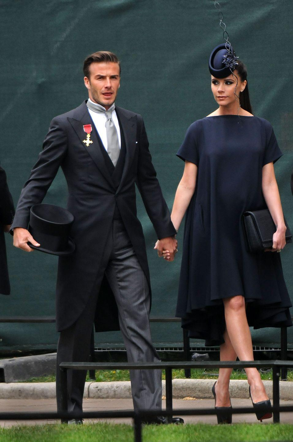 <p>Looking especially posh in a navy blue fascinator, fashion designer and erstwhile Spice Girl Victoria Beckham attends the royal wedding with her husband David.</p>