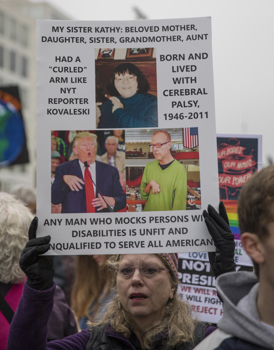 WASHINGTON, DC - JANUARY 21: A marcher attending the Women's March on Washington holds up a sign criticizing President Trump's treatment of a physically challenged New York Times reporter Serge Kovaleski on January 21, 2017 in Washington, DC. (Photo by Robert Nickelsberg/Getty Images)