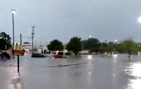 A parking is flooded after the heavy rains in Illinois, U.S., June 18, 2018, in this still image taken from a video obtained from social media. Picture taken June 18, 2018. Facebook/Ovidio Aldana/via REUTERS