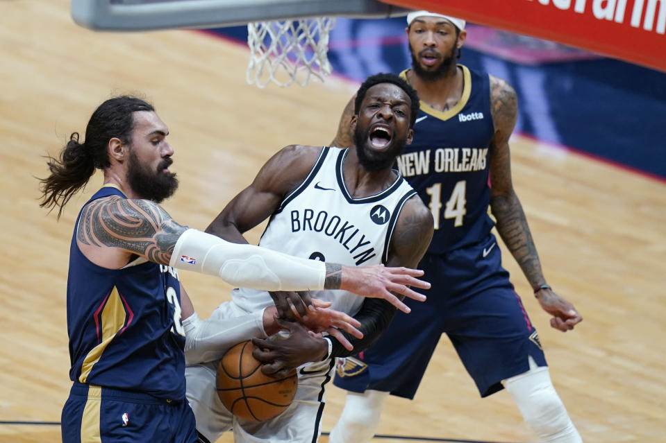 Brooklyn Nets forward Jeff Green is fouled by New Orleans Pelicans center Steven Adams as he goes to the basket in the first half of an NBA basketball game in New Orleans, Tuesday, April 20, 2021. (AP Photo/Gerald Herbert)