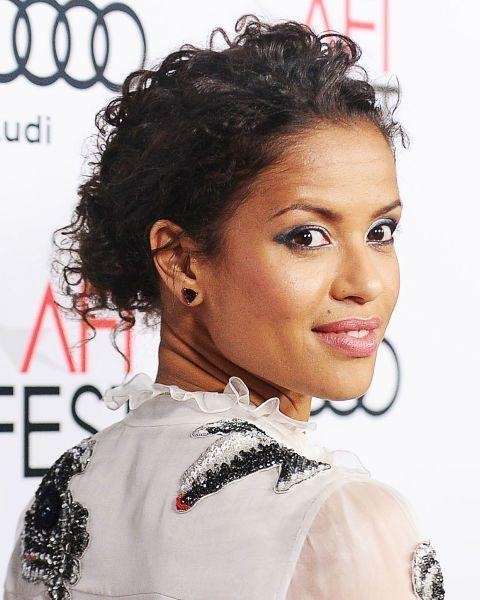 <p>Curly hair in a textured updo looks epic.</p>