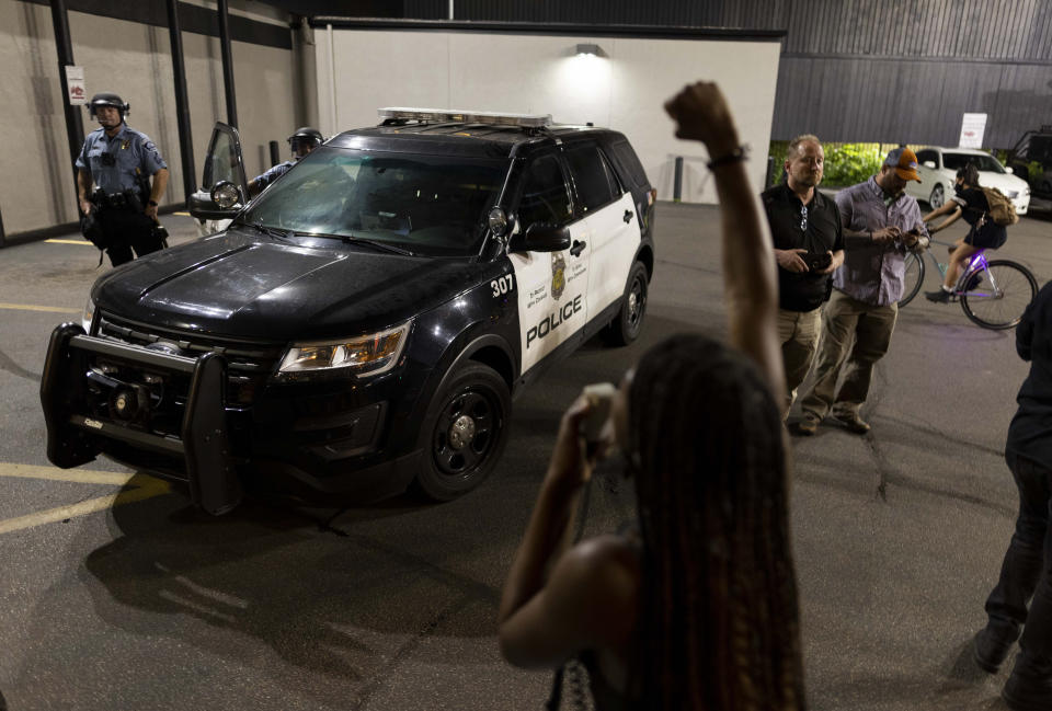 Protesters clash with police after a vigil held for Winston Boogie Smith Jr. early Saturday, June 5, 2021. Smith was shot and killed by law enforcement officers on Thursday during an arrest warrant operation. (AP Photo/Christian Monterrosa)