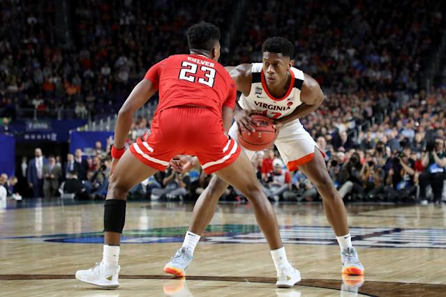 De'Andre Hunter #12 of the Virginia Cavaliers is defended by Jarrett Culver #23 of the Texas Tech Red Raiders in the second half during the 2019 NCAA men's Final Four National Championship game at U.S. Bank Stadium on April 08, 2019 in Minneapolis, Minnesota. (Photo by Streeter Lecka/Getty Images)
