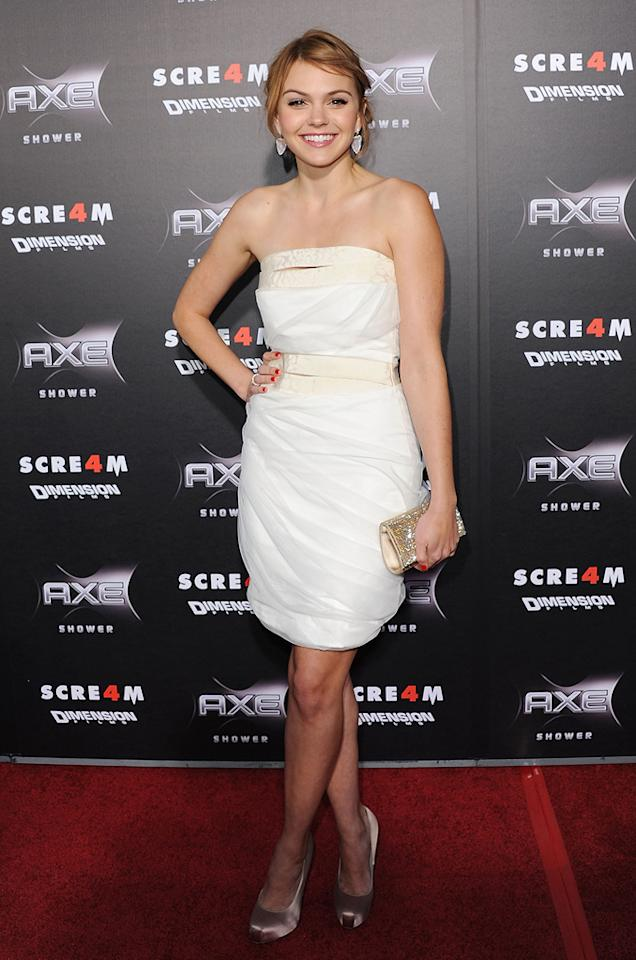 """21-year-old """"Friday Night Lights"""" alum <a href=""""http://movies.yahoo.com/movie/contributor/1810177626"""">Aimee Teegarden</a> looked incredibly mature in a strapless cocktail frock and metallic platform pumps."""