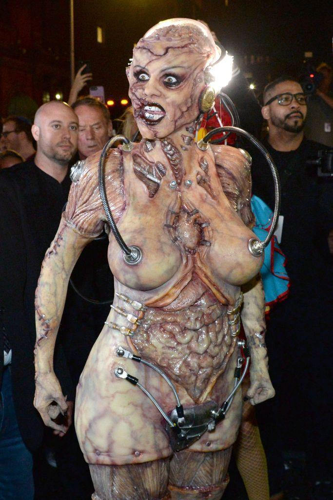 <p>Heidi got ready for her 20th annual Halloween party in an Amazon store window with a live audience looking on. </p>