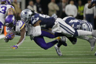 Minnesota Vikings running back Dalvin Cook (33) is tackled by Dallas Cowboys middle linebacker Jaylon Smith (54) in the second half of an NFL football game in Arlington, Texas, Sunday, Nov. 10, 2019. (AP Photo/Michael Ainsworth)