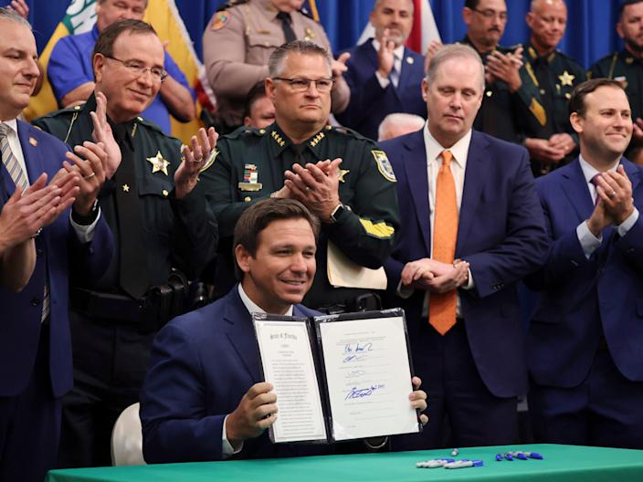 Ron DeSantis holds a news conference at the Polk County Sheriff's Office in Winter Haven, Florida on Monday, April 19, 2021.  (AP)