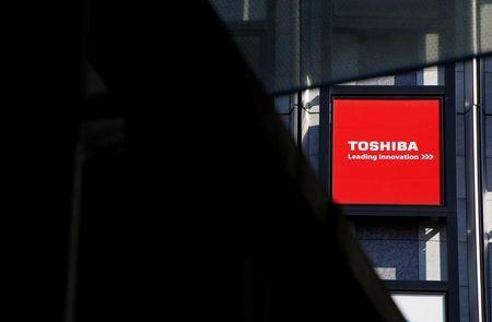 Logo of Toshiba Corp is seen outside an electronics retail store in Tokyo