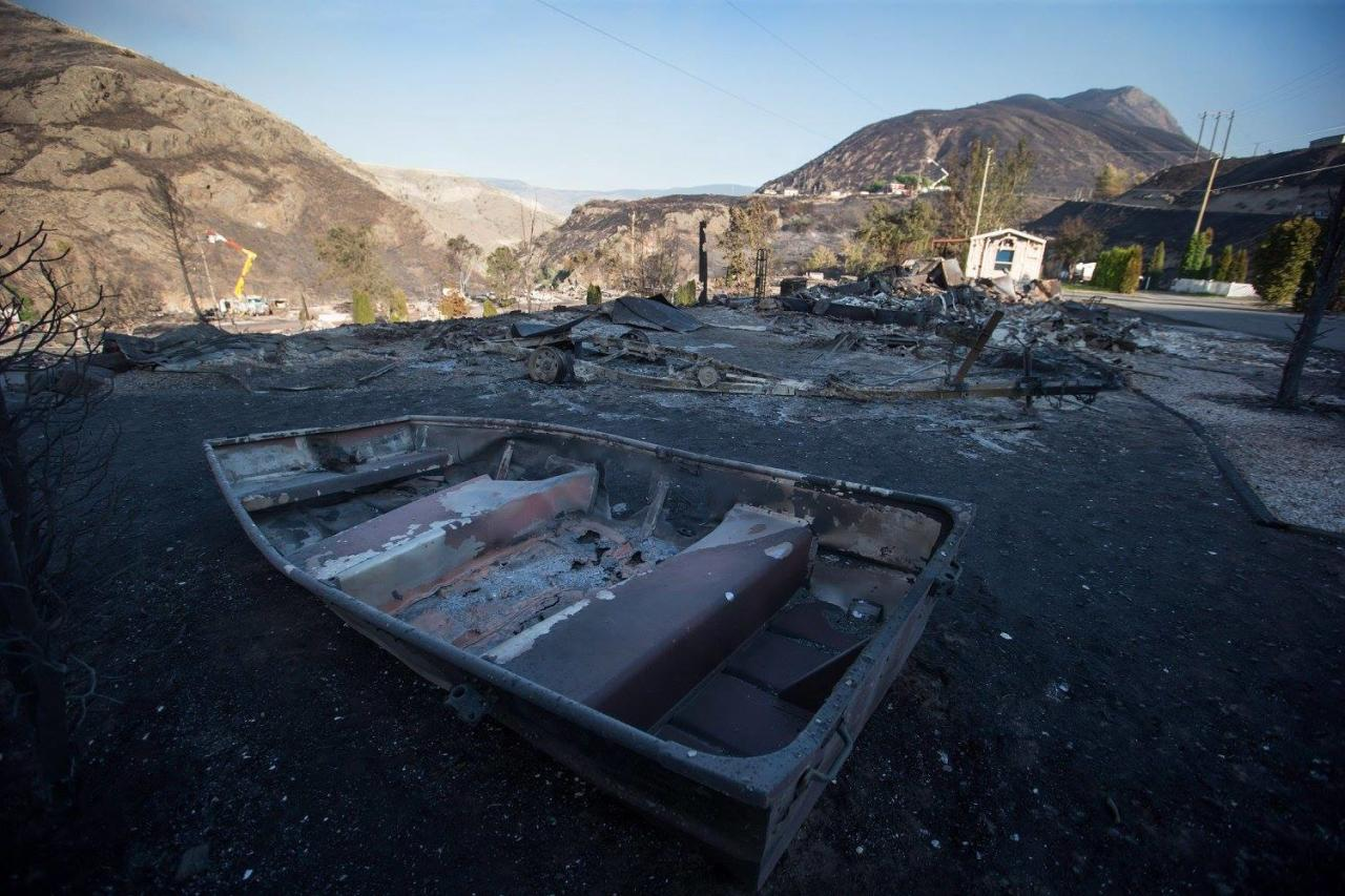 <p>The remains of a boat are seen on a property at a trailer park almost completely destroyed by wildfire in Boston Flats, B.C. Photo from The Canadian Press </p>