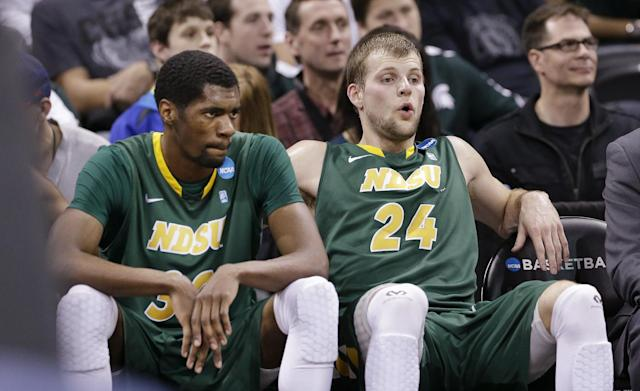 North Dakota State's Taylor Braun (24) and TrayVonn Wright sit on the bench for the final seconds against San Diego State in the second half during the third round of the NCAA men's college basketball tournament in Spokane, Wash., Saturday, March 22, 2014. San Diego State won 63-44. (AP Photo/Elaine Thompson)