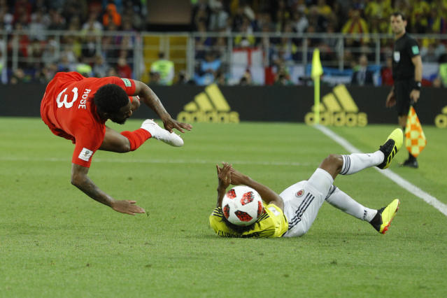 <p>Colombia's Juan Cuadrado, right, fouls England's Danny Rose during the round of 16 match between Colombia and England at the 2018 soccer World Cup in the Spartak Stadium, in Moscow, Russia, Tuesday, July 3, 2018. (AP Photo/Victor R. Caivano) </p>