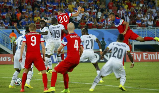 John Brooks (R) of the U.S. scores a goal during the 2014 World Cup Group G soccer match between Ghana and the U.S. at the Dunas arena