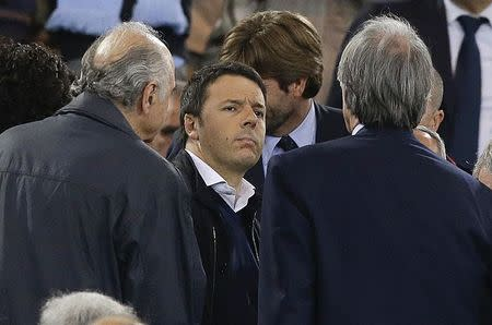 Italian Prime Minister Matteo Renzi stands on the tribune before the Italian Cup final soccer match between Fiorentina and Napoli at the Olympic stadium in Rome May 3, 2014. REUTERS/Giampiero Sposito