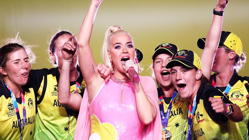 Katy Perry is pictured on stage with the Australian cricket team team after their victory in the ICC Women's T20 Cricket World Cup.