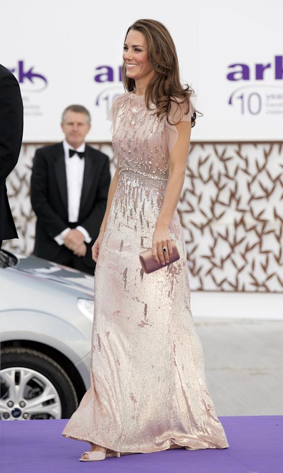 """<p><a rel=""""nofollow"""" href=""""https://www.popsugar.com/fashion/Kate-Middleton-Jenny-Packham-Dresses-31033402"""">Kate taps the brand for so many fancy occasions</a>, and she wore this dusty rose, sparkling number more than once. Kate paired it with an elegant clutch and pumps for the ARK 10 Anniversary Gala in June 2011 in London.</p>"""