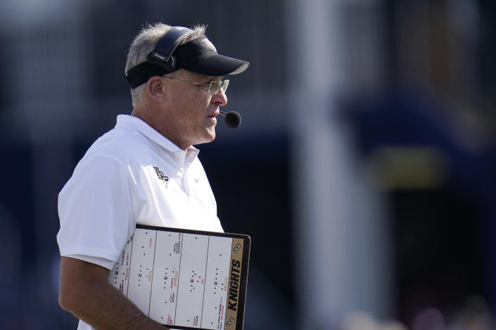 UCF head coach Gus Malzahn looks on during the first half of an NCAA college football game against Navy, Saturday, Oct. 2, 2021, in Annapolis, Md. (AP Photo/Julio Cortez)