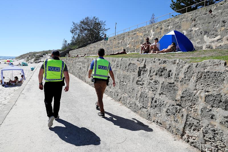 Police officers are seen patrolling Cottesloe Beach in Perth. Source: AAP