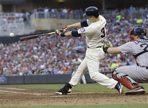 Minnesota Twins' Justin Morneau hits an RBI single off Boston Red Sox pitcher Ryan Dempster in the fourth inning of a baseball game, Saturday, May 18, 2013, in Minneapolis. (AP Photo/Jim Mone)
