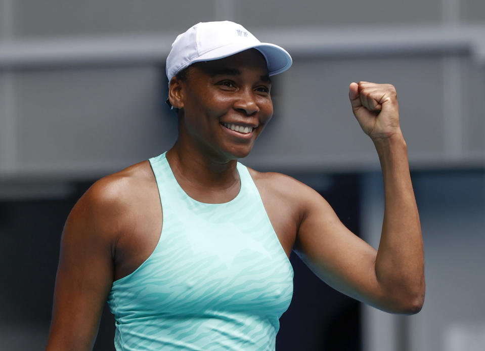United States' Venus Williams celebrates after defeating Belgium's Kirsten Flipkens in their first round match at the Australian Open tennis championship in Melbourne, Australia, Monday, Feb. 8, 2021.(AP Photo/Rick Rycroft)