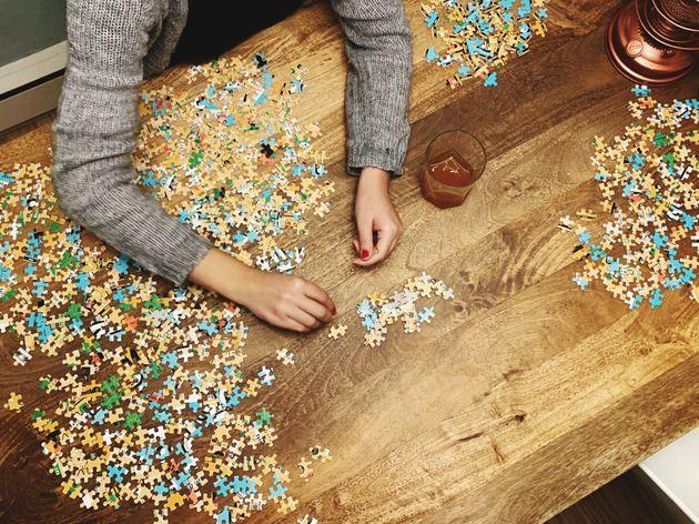 There are psychological reasons to explain the appeal of jigsaw puzzles amid the pandemic.