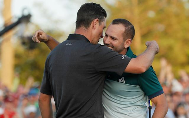 <span>Justin Rose and Sergio Garcia embrace after finishing the 18th tied for the lead</span> <span>Credit: AP </span>