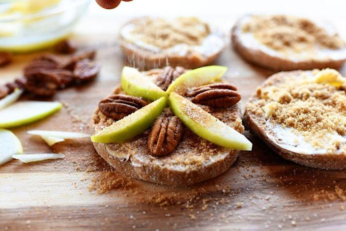 """<p>Apple pie fans will love this easy snack that tastes just like a scrumptious baked pie. But unlike pie, this recipe only takes 15 minutes to make! </p><p><a href=""""https://www.thepioneerwoman.com/food-cooking/recipes/a57630/apple-pecan-mini-pies/"""" rel=""""nofollow noopener"""" target=""""_blank"""" data-ylk=""""slk:Get Ree's recipe."""" class=""""link rapid-noclick-resp""""><strong>Get Ree's recipe.</strong></a></p>"""