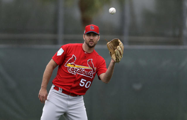 St. Louis Cardinals pitcher Adam Wainwright catches a ball during spring training baseball practice Wednesday, Feb. 13, 2019, in Jupiter, Fla. (AP Photo/Jeff Roberson)
