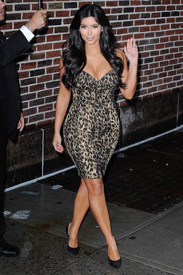 """Meow! Kim stunned in a strapless leopard-print frock from the clothing line she and sisters Kourtney and Khloe designed for the Kardashian Kollection for Sears while they promoted the brand on """"Late Show With David Letterman"""" in September. Looks like Dave got an eyeful! (September 5, 2011)"""