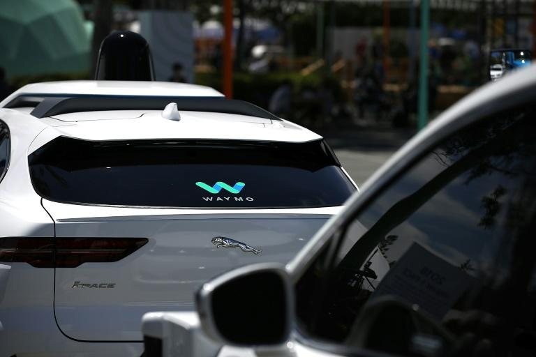 Waymo self-driving vehicles are seen near the Google headquarters in Mountain View, California in 2018