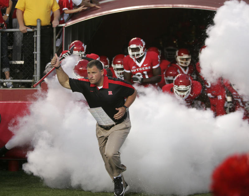 Greg Schiano leads Rutgers Scarlet Knights onto the field before their college football game against North Carolina Central Eagles on Sept. 1, 2011. (Rich Schultz/Getty Images)
