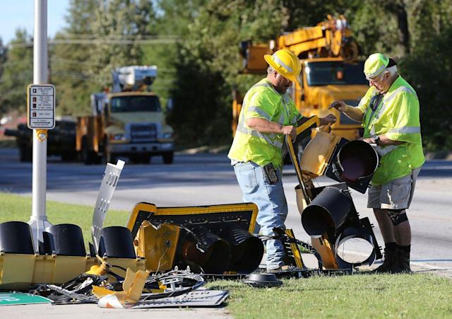 <p>Georgia Department of Transportation workers help repair downed street lights and power along Highway 307 in Savannah, Ga., in the aftermath of Hurricane Matthew on Sunday, Oct. 9, 2016. (Photo: Curtis Compton/Atlanta Journal-Constitution via AP) </p>