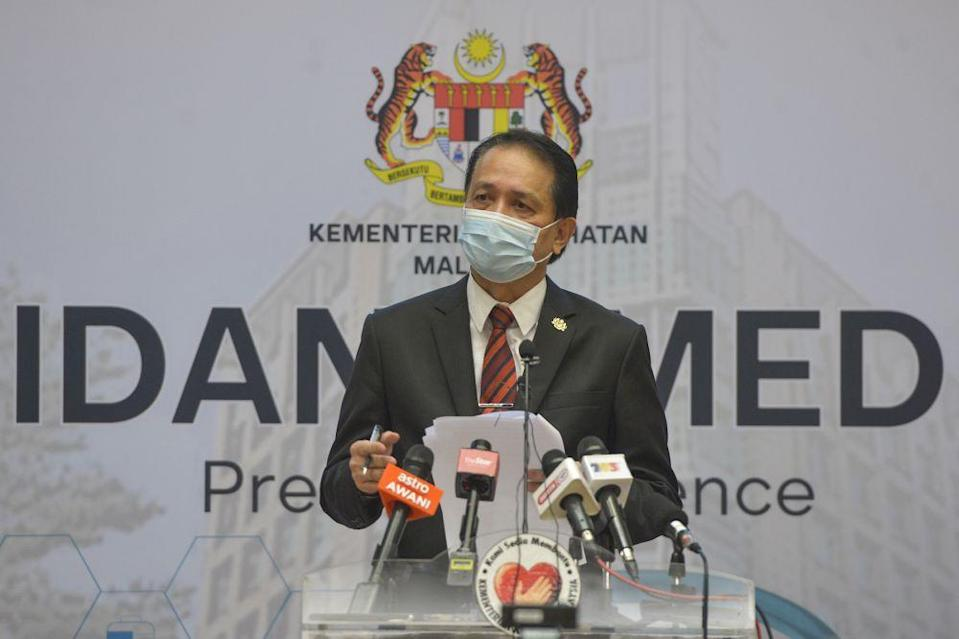 Health director-general Tan Sri Dr Noor Hisham Abdullah speaks during a press conference in Putrajaya on December 9, 2020. — Picture by Miera Zulyana