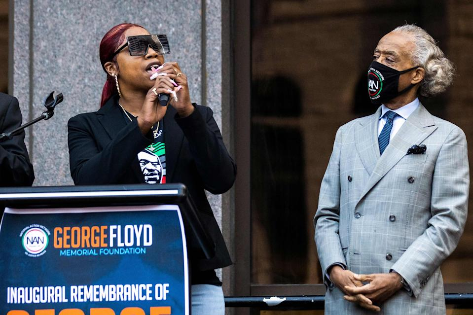 George Floyd's sister Bridgett Floyd speaks, flanked by Rev Al Sharpton, during a remembrance for her brother in MinneapolisAFP via Getty Images
