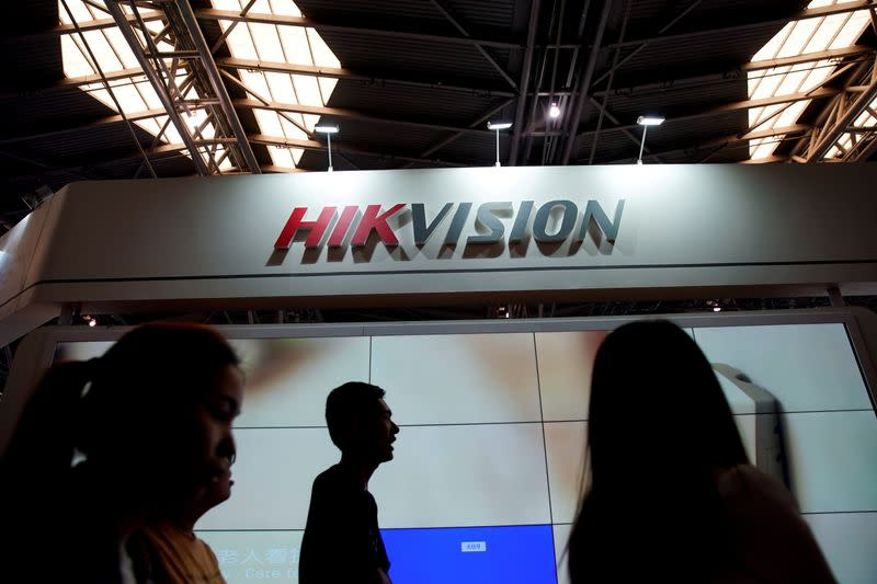 FILE PHOTO: People visit a HIKVision booth at the security exhibition in Shanghai