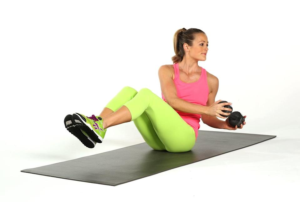 <p>This classic move targets your obliques, and adding a dumbbell or medicine ball increases the challenge.</p> <ul> <li>Holding a dumbbell in both hands, sit on the ground with your knees bent and your heels about a foot from your butt. You can also make the move more advanced by lifting your feet three or four inches off the floor, as pictured.</li> <li>Lean slightly back without rounding your spine at all. It is really important, and difficult, to keep your back straight.</li> <li>Pull your navel to your spine, and twist slowly to the left, bringing the weight to your left side. The movement is not large and comes from the ribs rotating, not from your arms swinging. Inhale through center, and rotate to the right. This completes one rep.</li> </ul>