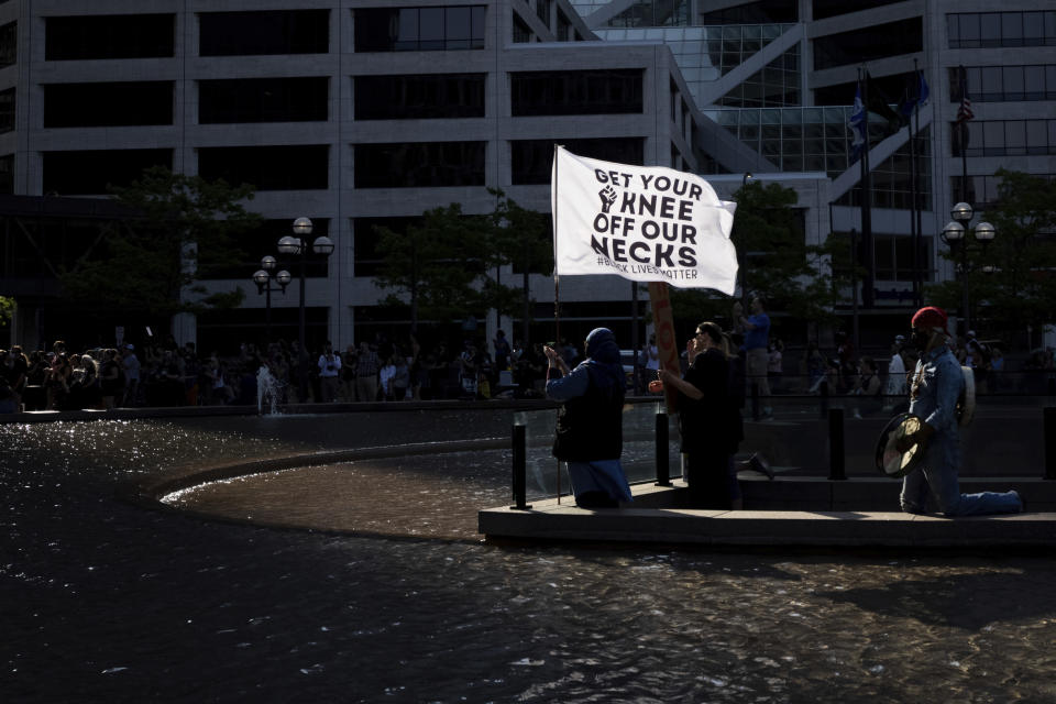 People attend a rally and march for the one year anniversary of George Floyd's death on Sunday, May 23, 2021, in Minneapolis, Minn. (AP Photo/Christian Monterrosa)