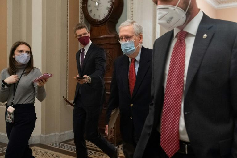US Senate Majority Leader Mitch McConnell, Republican of Kentucky, walks to the Senate Floor at the US Capitol in Washington, DC on December 18, 2020