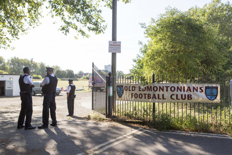 Police officers outside Old Edmontonians Football Club in Jubilee Park, Edmonton, following the fatal stabbing of a 29-year-old man. Birthday party guests attending a party at the Old Edmontonians FC clubhouse, sat on the suspected attacker until police arrived following the attack in north London, a witness has claimed.