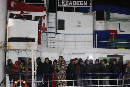Migrants stand on the deck of Sierra Leone-flagged vessel Ezadeen as they arrive at Corigliano Calabro harbor in southern Italy early January 3, 2015. REUTERS/Antonino Condorelli