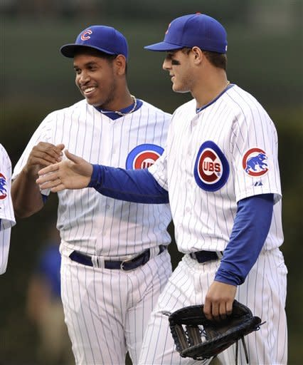 Chicago closing pitcher Carlos Marmol left, celebrates with teammate Anthony Rizzo right, after defeating the Pittsburgh Pirates 13-9 in a baseball game in Chicago, Sunday, Sept. 16, 2012. (AP Photo/Paul Beaty)