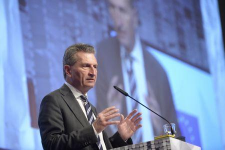 FILE PHOTO: Guenther Oettinger delivers a speech at the world's biggest computer and software fair CeBit in Hanover, Germany, March 14, 2016
