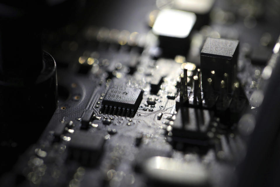 FILE - This Feb 23, 2019, file photo shows the inside of a computer in Jersey City, N.J. A ransomware attack paralyzed the networks of at least 200 U.S. companies on Friday, July 2, 2021, according to a cybersecurity researcher whose company was responding to the incident. (AP Photo/Jenny Kane, File)