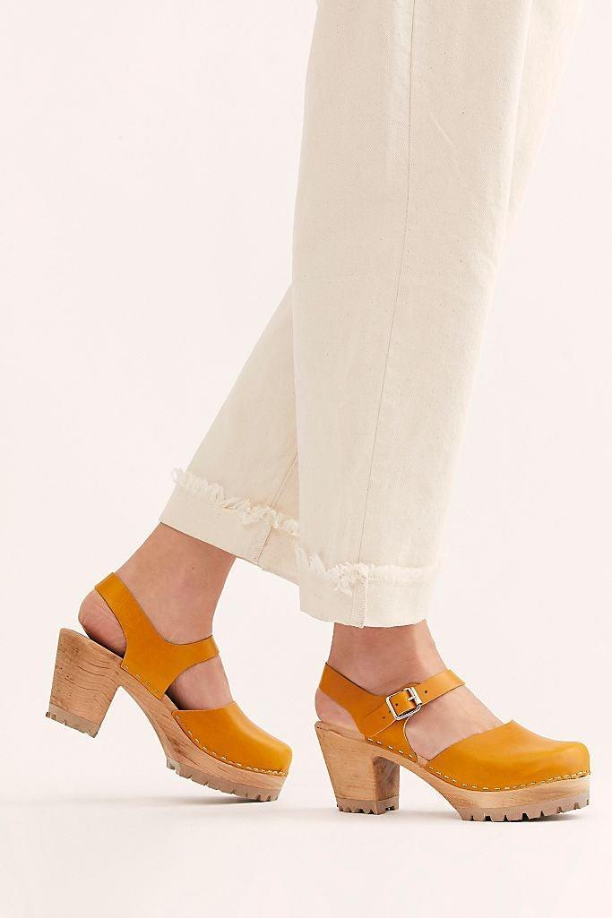 "<h3><h2>MIA Abba Clog</h2></h3><br>While you might know contemporary brand MIA for a wealth of footwear styles, you might not know that they actually started out as Mia Clogs in the 1970s. And we'd venture that their best-selling, disco-inspired wood-heel platform is still one of their coolest kicks.<br><br><strong>MIA Shoes</strong> Abby Clog, $, available at <a href=""https://go.skimresources.com/?id=30283X879131&url=https%3A%2F%2Fwww.freepeople.com%2Fshop%2Fabby-clog%2F%3F"" rel=""nofollow noopener"" target=""_blank"" data-ylk=""slk:Free People"" class=""link rapid-noclick-resp"">Free People</a>"