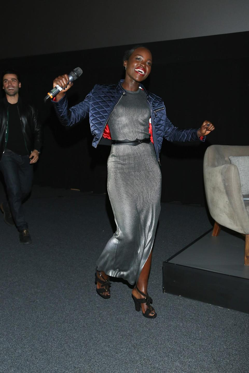 <p>For the Mexico City premiere of <i>Star Wars: The Force Awakens</i>, Nyong'o wore this season's must-have trend: the bomber jacket. Paired with strappy black sandals and a slinky silver dress by Louis Vuitton, she's obviously ready to party hard.</p><p><i>Photo: Getty Images</i></p>