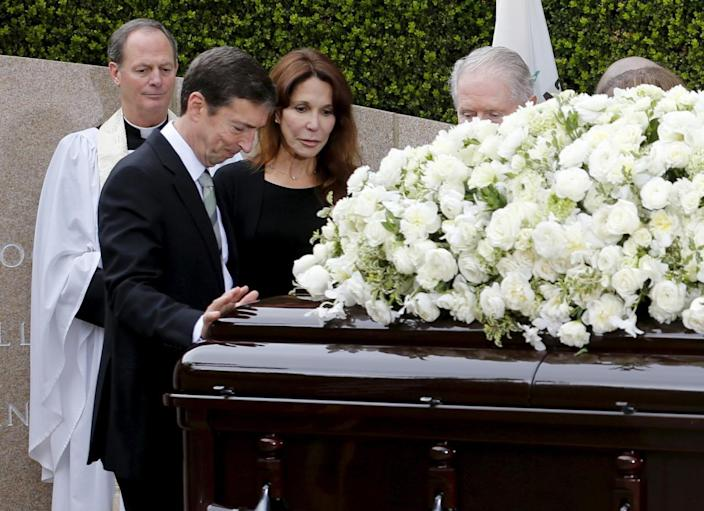 <p>Ron Reagan and his sister, Patti Davis, pay their respects to their mother during the funeral for former first lady Nancy Reagan on Friday, March 11, 2016. <i>(Photo: Mike Blake/Reuters)</i></p>