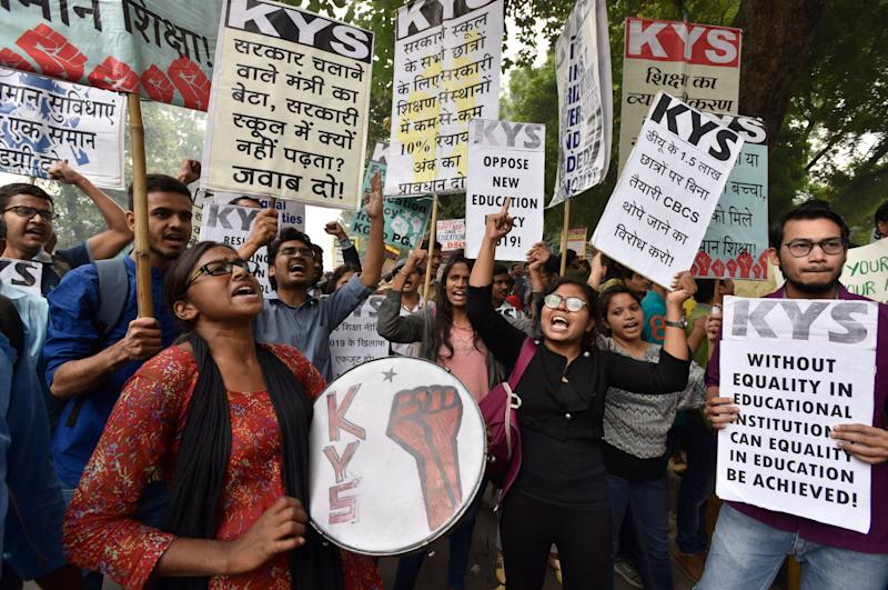 Teachers and students from various universities hold placards and shout slogans during a protest march from Mandi House to Jantar Mantar against the New Education Policy and JNU's hostel fee hike on November 14, 2019 in New Delhi. (Photo: Hindustan Times via Getty Images)