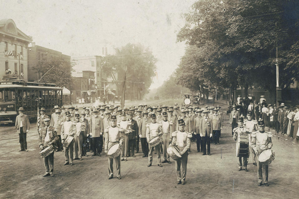 In this July 4, 1910 photo made available by the Library of Congress, United Confederate Veterans from the Civil War march with drummers down a street in Petersburg, Va. On July 4, 1776, the Continental Congress formally endorsed the Declaration of Independence. Celebrations began within days: parades and public readings, bonfires and candles and the firing of 13 musket rounds, one for each of the original states. Nearly a century passed before the country officially named its founding a holiday. (Library of Congress via AP)