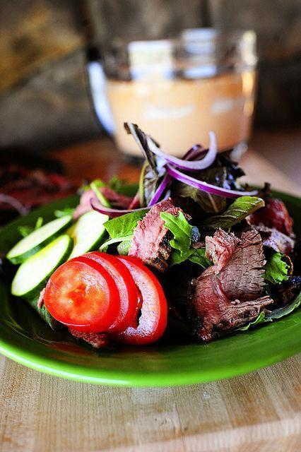 """<p>Thin, elegant strips of steak and a fiery chipotle dressing make this salad an impressive option for your next date night or get-together. </p><p><strong><a href=""""https://www.thepioneerwoman.com/food-cooking/recipes/a10271/chipotle-steak-salad/"""" rel=""""nofollow noopener"""" target=""""_blank"""" data-ylk=""""slk:Get the recipe"""" class=""""link rapid-noclick-resp"""">Get the recipe</a>.</strong></p><p><a class=""""link rapid-noclick-resp"""" href=""""https://go.redirectingat.com?id=74968X1596630&url=https%3A%2F%2Fwww.walmart.com%2Fbrowse%2Fhome%2Ffood-storage-containers%2Fthe-pioneer-woman%2F4044_623679_1032619_5842891%2FYnJhbmQ6VGhlIFBpb25lZXIgV29tYW4ie&sref=https%3A%2F%2Fwww.thepioneerwoman.com%2Ffood-cooking%2Fmeals-menus%2Fg35191871%2Fsteak-dinner-recipes%2F"""" rel=""""nofollow noopener"""" target=""""_blank"""" data-ylk=""""slk:SHOP FOOD STORAGE"""">SHOP FOOD STORAGE</a></p>"""
